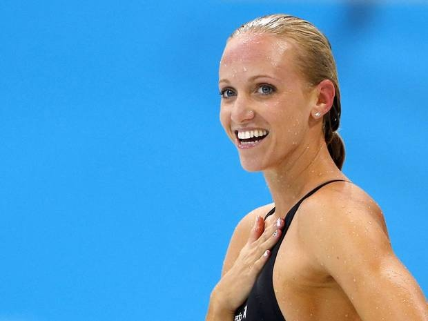 Dana Vollmer of the U.S. reacts after winning the women's 100m butterfly final during the London 2012 Olympic Games