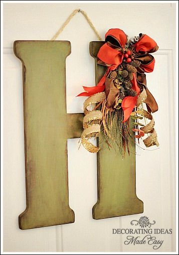 Fall door decoration using a large wood letter from Hobby Lobby!  Jenniferdecorates.com