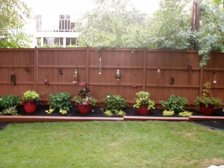 Outdoor Landscape - Backyard Fence - We overhauled the fence and this portion of the backyard in 2011.  To find the parts and pieces used, please visit us at our blog :)  http://emodelyourhome.wordpress.com/2013/05/15/outdoor-landscape-2011/
