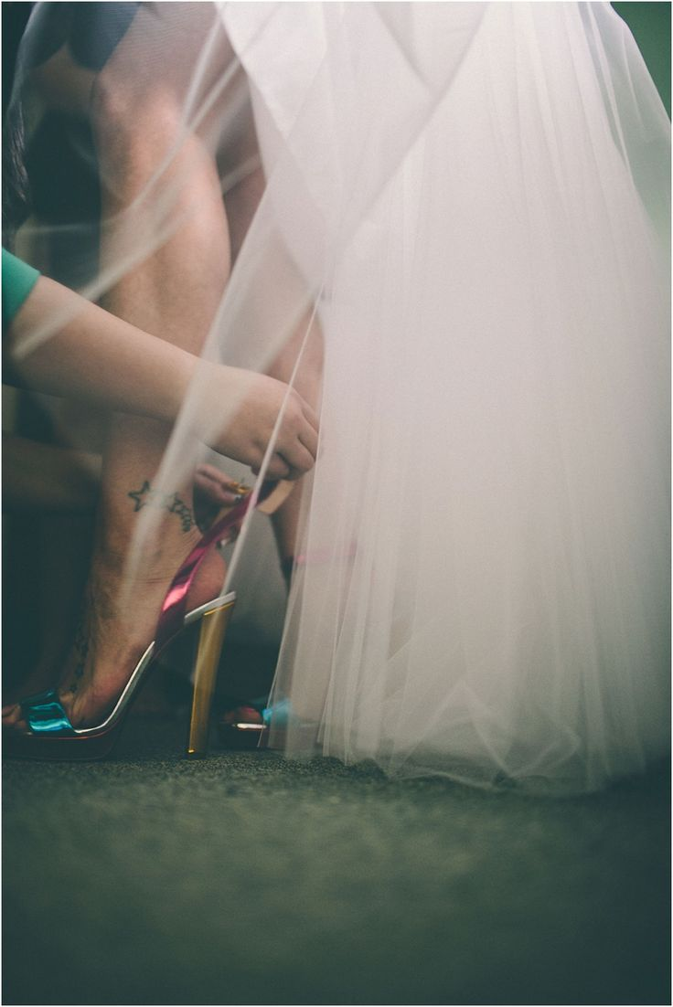 Wedding shoes | rock n roll | rock chick | quirky | candid | reportage wedding photography | pink shoes | wedding dress | bride
