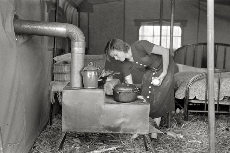 """October 1938. """"Tent of migrant stove maker and repairer on U.S. 90 near Jeanerette, Louisiana."""" - Shorpy Historical Photo Archive :: Stovepipe Hut: 1938"""