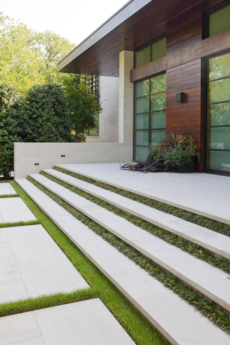 Facade of a Modern Home Featuring Floating Concrete Stairs Separated By Grass Strips | HGTV
