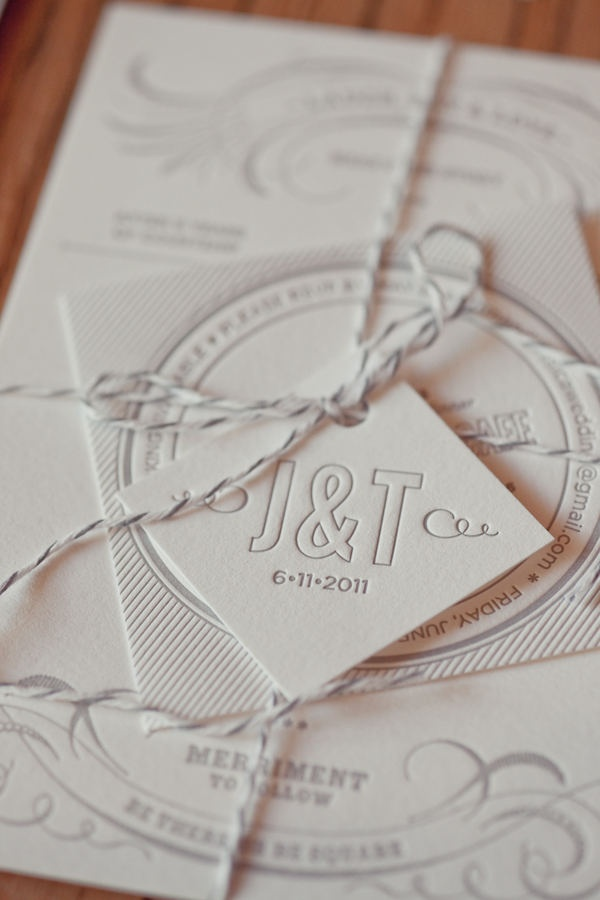 Love the monogram tied as a tag on top of the invitation packet