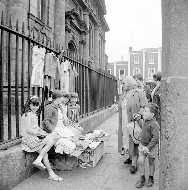 Snapped in 1969. Selling clothes in Thomas Street, Dublin on the steps of St Catherines Church.