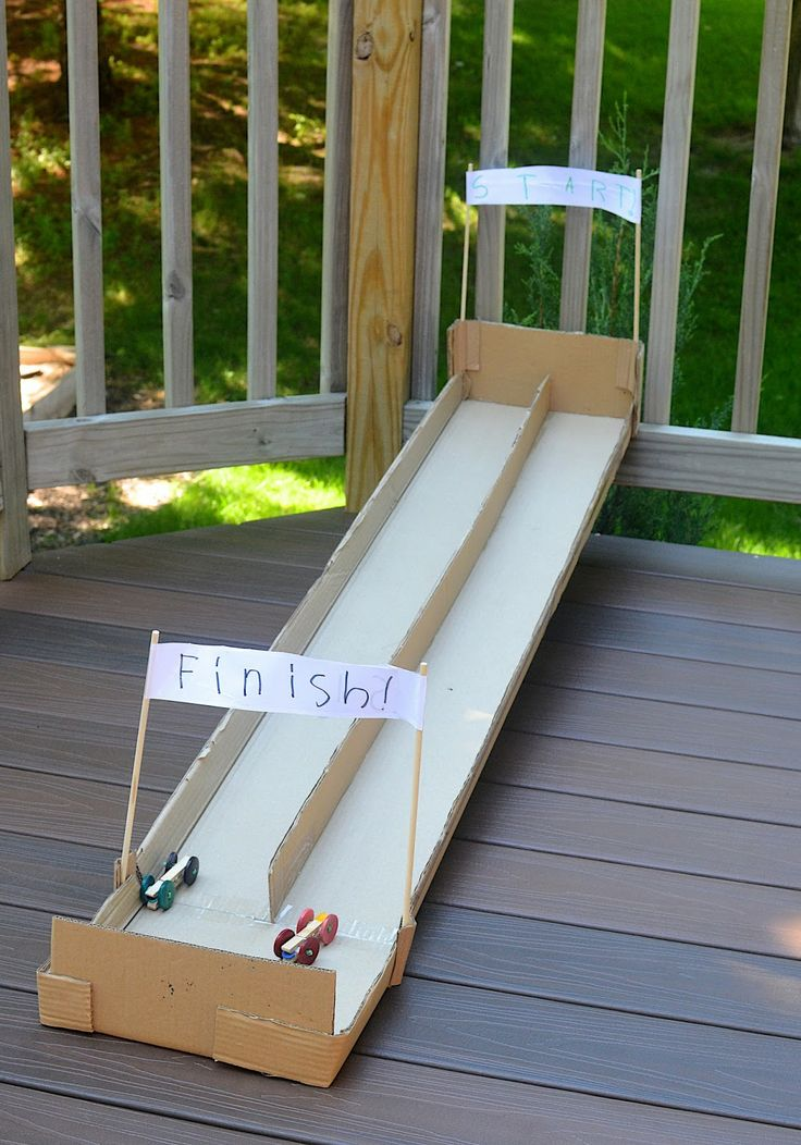 Clothespin cars and a cardboard race car track