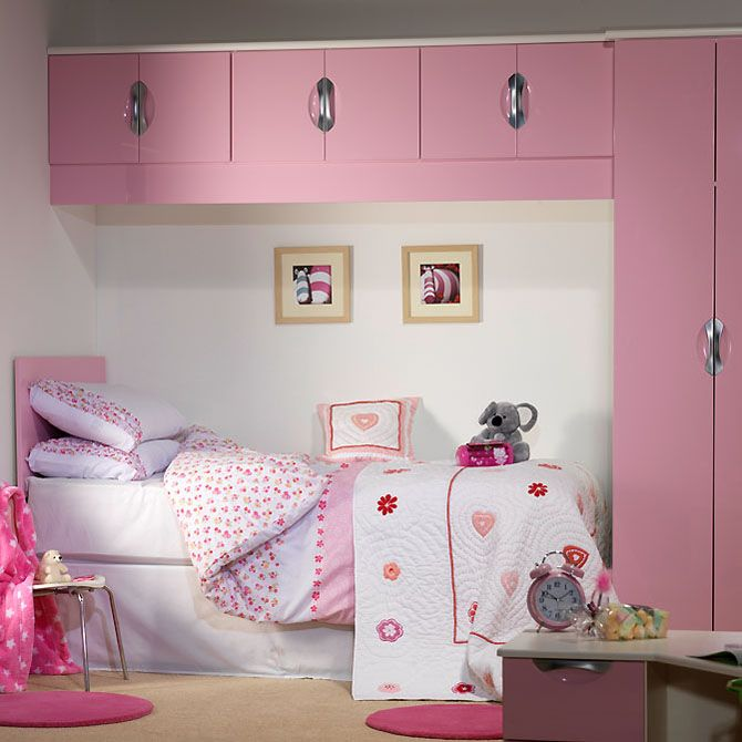 Overhead storage and side wardrobe highlights how you can make the most of space in a small girls bedroom. http://www.starplanbedrooms.com/ranges/view/childrens-bedrooms/