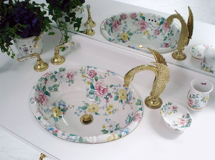 Hand Painted Sink Chintz Flowered Basin And Accessories In A Mirrored Bathroom