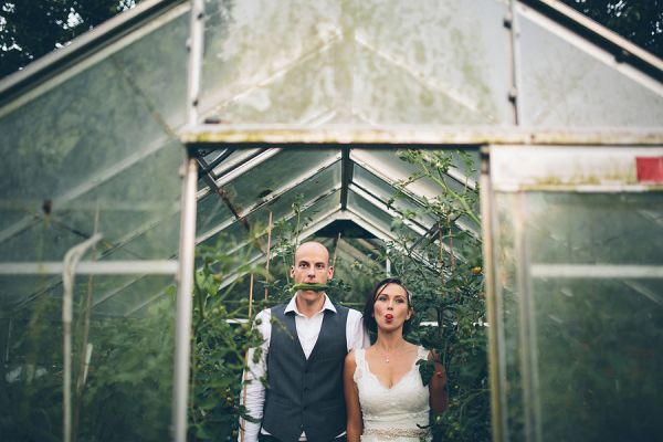playful couple in greenhouse, photo by Liam Crawley of CG Weddings by The Crawleys - England | via junebugweddings.com