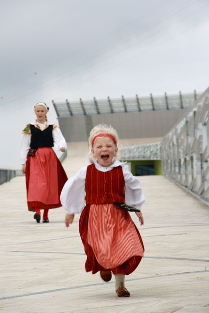 Happy Finnish girls in traditional costumes.