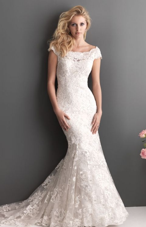 Allure Bridal- 2610: Soft and romantic. This slim, fitted gown features a delicate lace throughout. The scoop neckline features an off-the-shoulder cap sleeve with a V-shaped back.