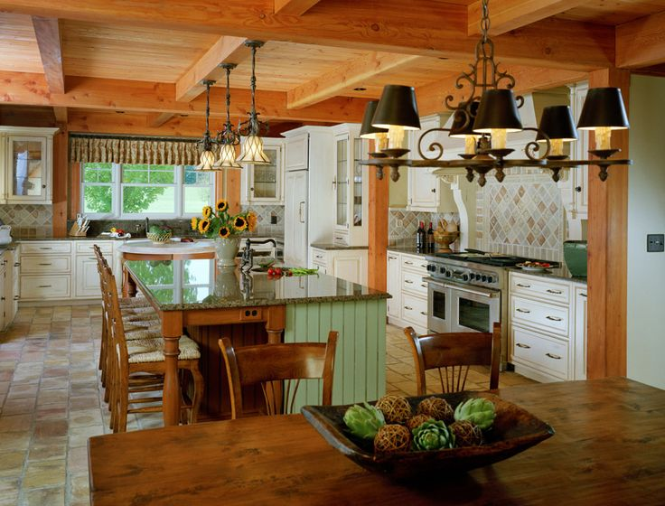 country kitchen with exposed wood beam ceiling and tile floor