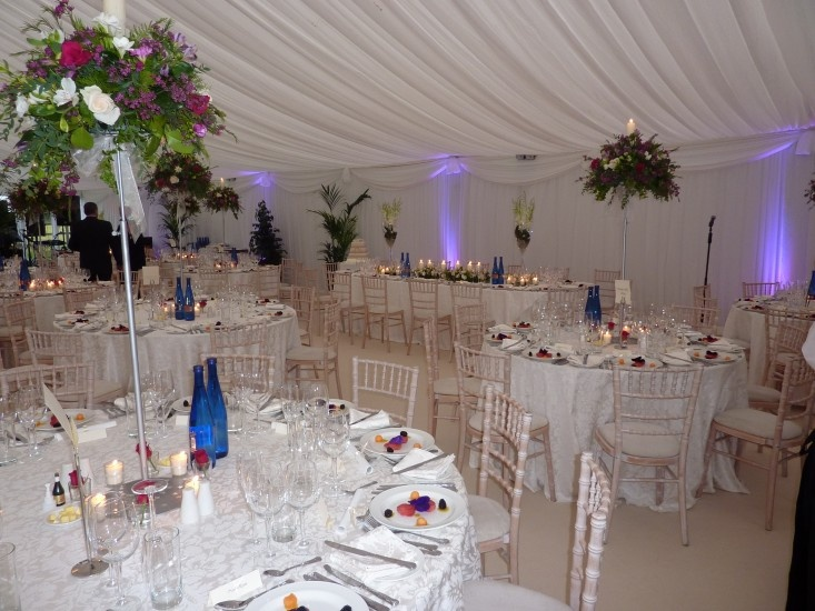 Grecian hand made swags in Marquee and floral centre pieces with candles