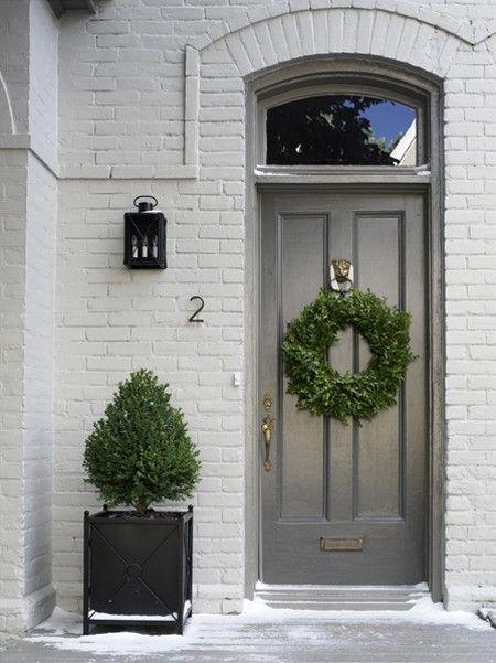 grey door and white brick