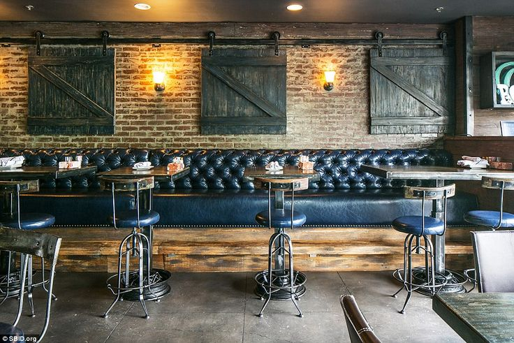 In Irvine in America, Bosscat Kitchen & Libations has a  more down-to-earth feel:The restaurant's design vision was to create a space with a rustic farm feel in the centre of a modern city