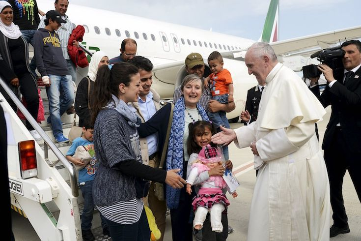 'You are not alone,' Pope Francis tells refugees, brings 12 to Rome