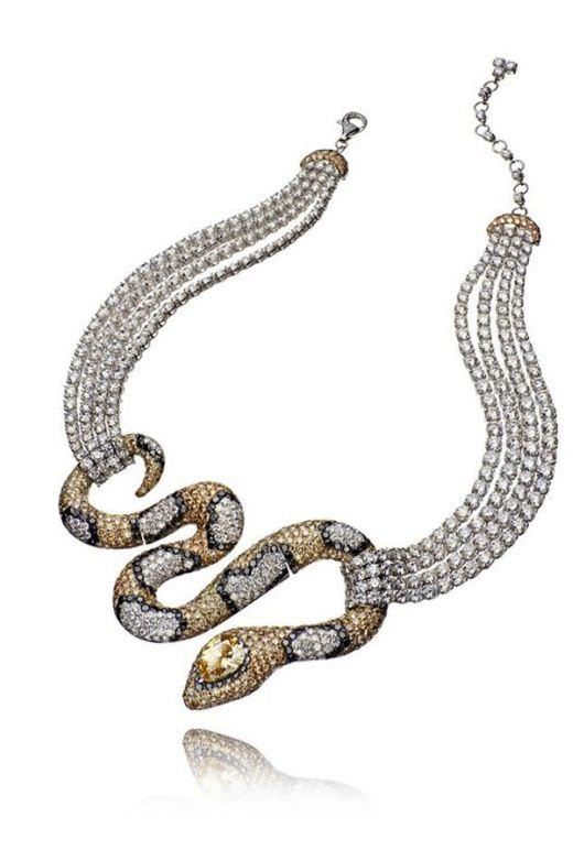 Amazonie necklace, 21ct of brown diamonds, 66ct of white and 11ct of black diamonds surround the 5ct pear-shaped brown diamond set in the snakes head
