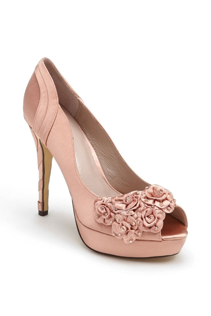 Menbur Peep Toe Pump available at why do they have to have a inch heel?