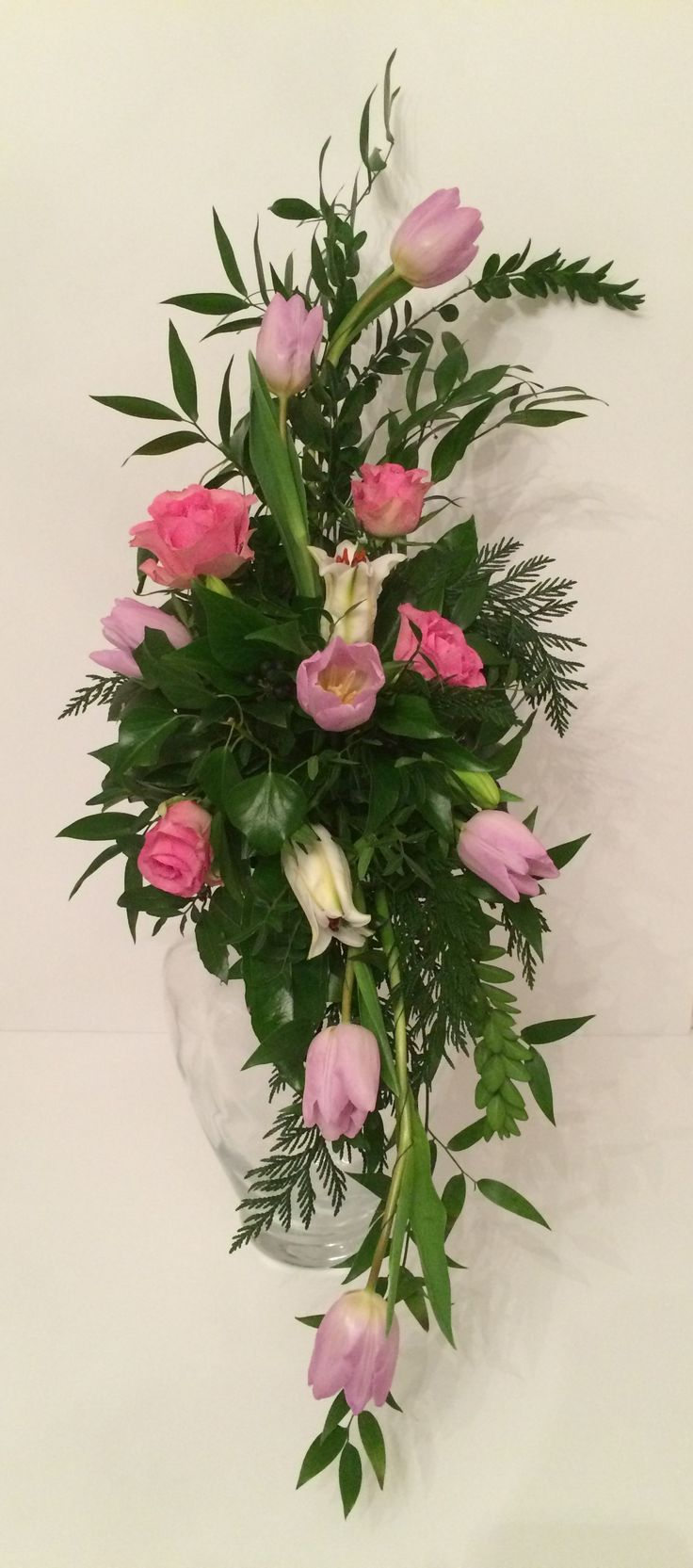 Classic Hogarth Curve Floral Arrangement With Tulips Lillies And Roses Arrangements Round