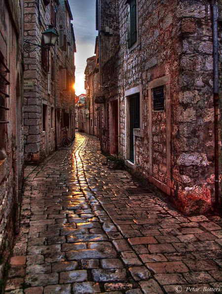 Sunset in old stone street Photo by Petar Botteri — National Geographic Your Shot