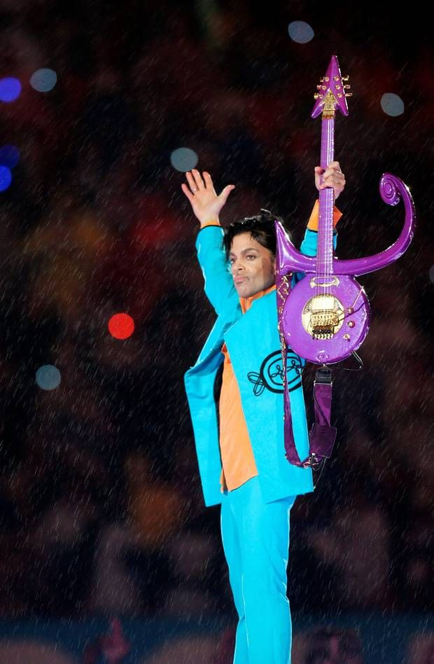 (FILES) This file photo taken on February 4, 2007 shows US musician Prince performing during half-time at Super Bowl XLI at Dolphin Stadium in Miami between the Chicago Bears and the Indianapolis Colts. Pop icon Prince -- one of the most influential but elusive figures in music -- died suddenly at his compound in Minnesota on April 21, 2016, a representative said. He was 57. / AFP PHOTO / Roberto SCHMIDTROBERTO SCHMIDT/AFP/Getty Images