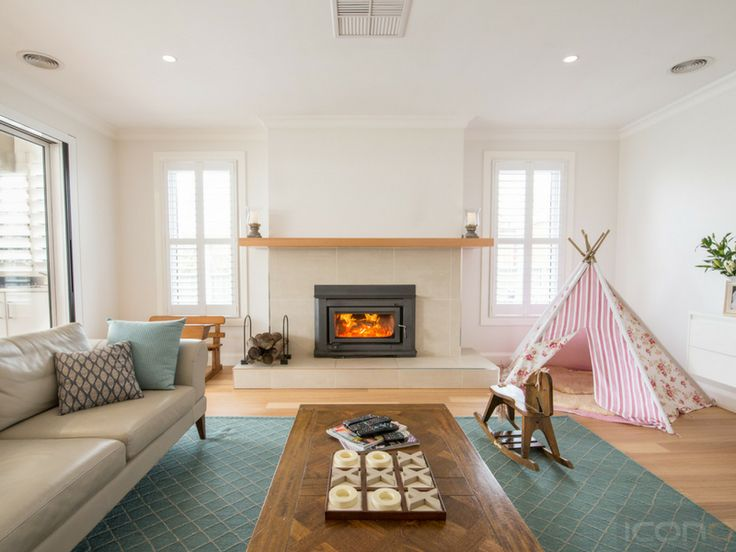 Such a beautiful family room! #familyroom #fireplace #homedecor #Australianhomes #iconobuildingdesign
