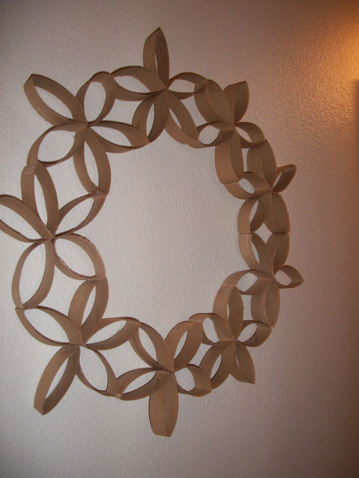Reuse toilet paper rolls to make wall art for your bathroom! Super easy!