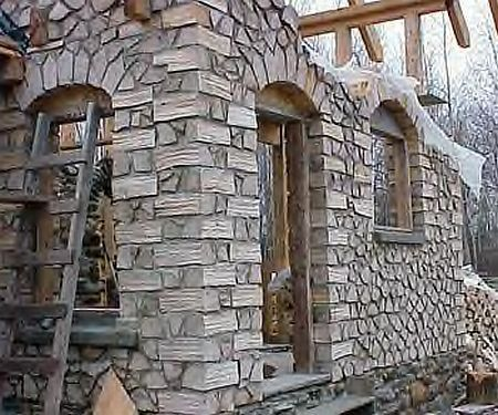 cordwood construction | The interior with its masonry stove and arches is quite a thing of ...