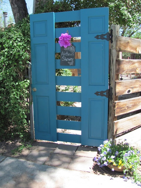 Garden Gate from a wooden door that was cut in half, some 1x6 boards (some were old window sills), a deadbolt, some cool hinges and a great paint color... Looks awesome!