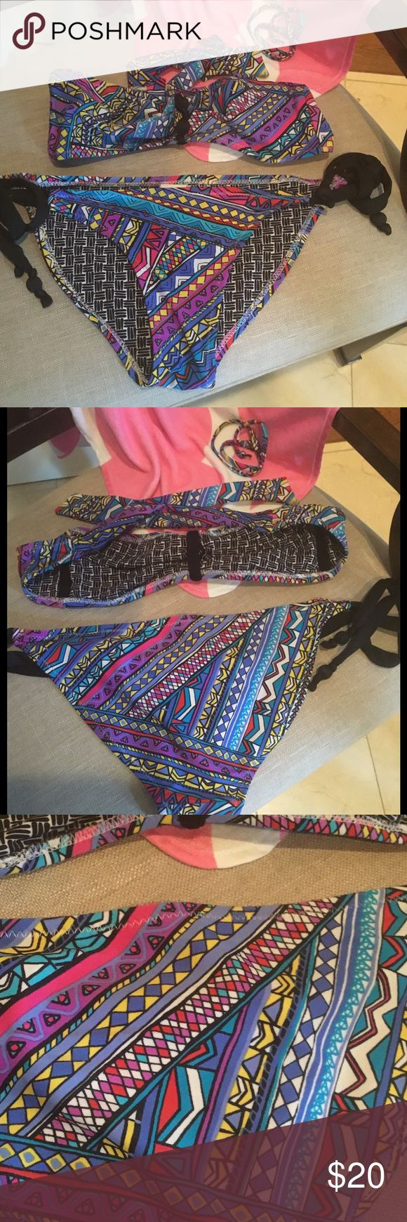 Cute Bandeau style Swimwear!  Adorable multi colored bandeau top with side tie matching bottoms. Xhilaration. Both top and bottom are size Small. Optional next strap. Bright colors of blue, teal, red, yellow and purple. Black accents. Excellent used condition!! Xhilaration Swim