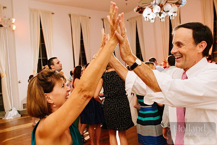 parents of the bride dance and celebrate at their daughter's destination wedding in Virginia