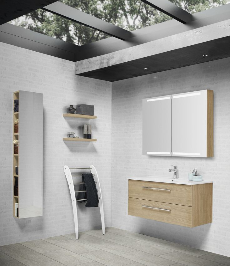 Thin Kantate washbasin and bathroom furniture in oak finish. Functional shelving unit with mirror and baskets.