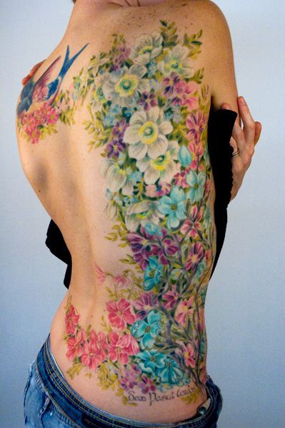 "Soft looking tattoos - watercolor (no black lines) technique is amazing! It is better than the traditional tattoo ""look"", but all this tattoo action still falls under my board ""Stuff That Cracks Me Up!"" (This woman's back will look like melted crayons by the time she hits 70! LOL!)"