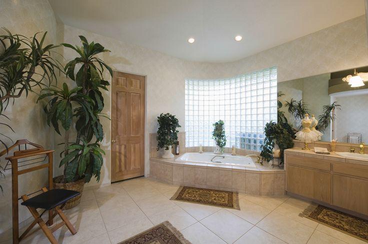 Przestronna łazienka z oknem z luksferów  Jak Wam się podoba?                       Spacious Bathroom At Home View of a spacious bathroom with glass brick window at home  #DecoArt24 #łazienka #Bathroom #inspiracje #interior #wnętrze
