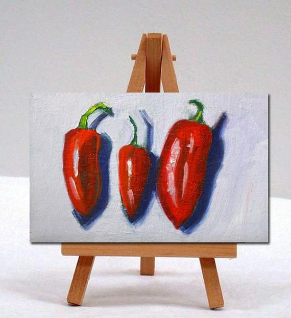 Title: Three Red Peppers Size: 4x6 inches Medium: Oil Painting Surface: Flat canvas panel  This 4x6 inch oil painting was created on a flat canvas panel with professional grade oil paints. It will fit easily into most standard sized frames though it is sold unframed and does not include an easel. Colors may vary slightly due to the differences in calibration of monitors. My paintings are shipped with insurance and tracking included.  You might like to view some of my other fruit or vegetable…