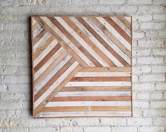 16.5in. W x 14.5in. H Handmade wood wall art with reclaimed wood pattern. We can customize sizes of this design in our shop if this one isnt just right for your space. We can customize the size and color for you, just let us know! This geometric design can be used on above a bed, sofa, or any wall needing some love. Can hung from any side.  Size, color and texture will have small variations due to the nature of reclaimed wood.  Made to order.  Made with raw reclaimed wood.  Can be…