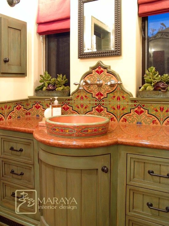 Mexican Style Design - really beautiful and elaborate tiles and curved vanity.  Love the wall mounted fixtures and the window boxes with cacti.