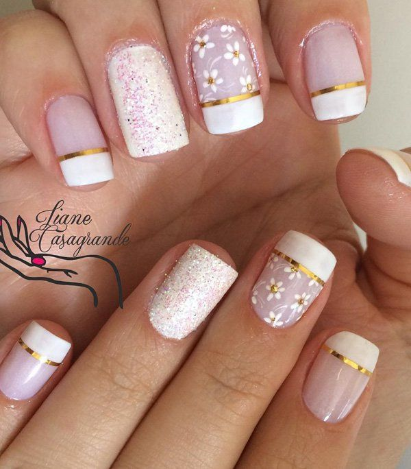The classic French tip? Check. Metallic gold strips? Check. Floral design? Check. Tiny sprinkles? Check. This is the perfect wedding nail art design.