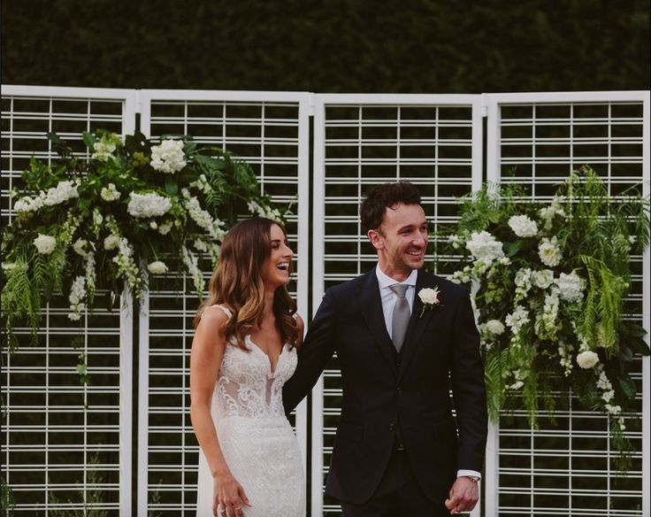 Liv and Nath's backdrop at Coombe Yarra Valley (made by Nath, decorated by Sugarbee Flowers)  Celebrant: Sally Hughes Image: Beck Rocchi Photography