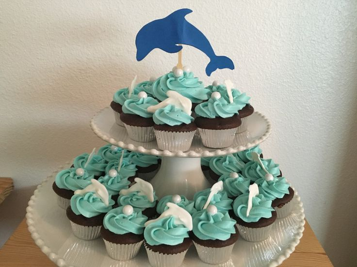 Dolphin and pearl mini cupcakes.  Perfect for an under the sea birthday party