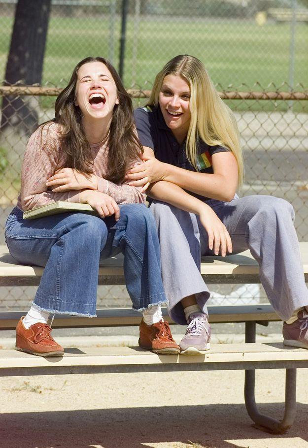Linda Cardellini and Busy Philipps sharing a laugh on set