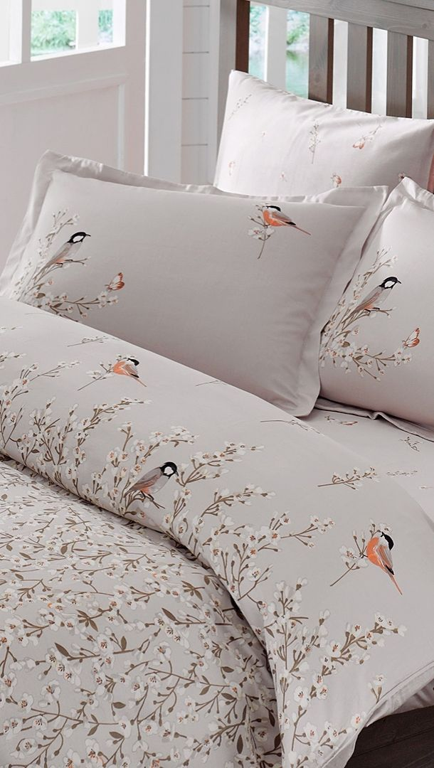 Inspire sweet dreams in the guest bedroom or master suite with the bird and flower patterned twill of the Eden Gray bamboo rayon duvet cover set.