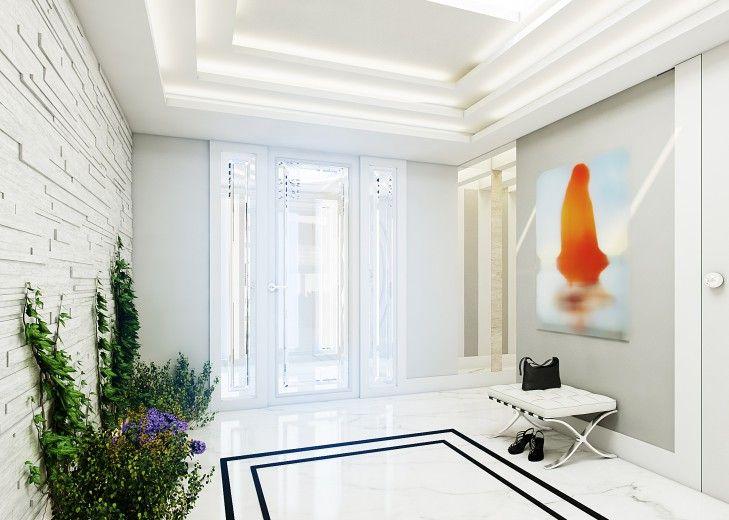 Projekt wnętrza holu w podmiejskiej willi. Niezwykłe wrażenie sprawia schodkowy sufit zakończony świetlikiem i jego odbicie w podłodze w postaci kontrastujących kolorów białego i czarnego marmuru.