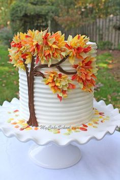Autumn Leaves in Chocolate - from My Cake School - candy melt leaves on buttercream. Looks surprisingly easy for such a dramatic result! mycakeschool.com