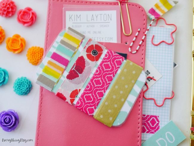 Wrap washi tape around a laminated credit card size piece of pretty paper or old gift cards. They fit great in the little pockets and keep your favorite washi tape right where you need it.