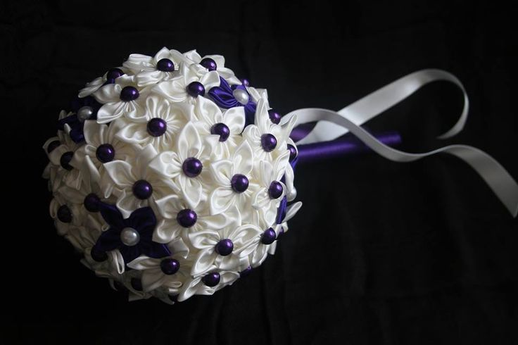 Ivory with dark purple bridesmaid bouquet.   www.facebook.com/DawneveCrafts