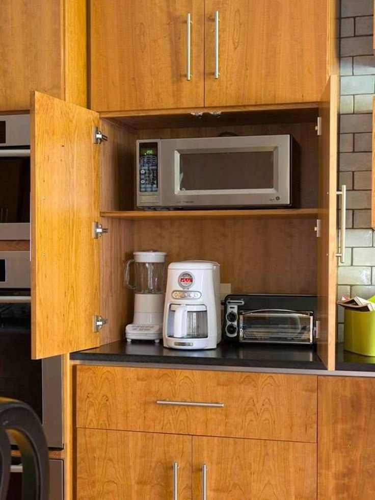 Tucking small appliances into cabinets for organize a for Kitchens for small kitchens