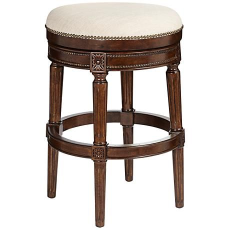 A Solid Birchwood Barstool In Walnut Finish With Brass