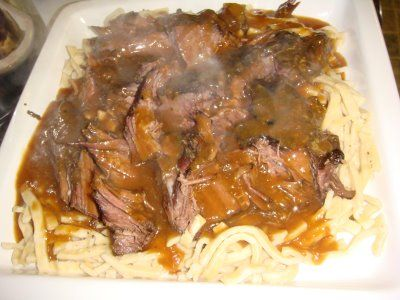 Crock Pot Sauerbraten. SOOO delish! And so simple too! All you need is a roast, beef broth, cider vinegar, onions, brown sugar and some gingersnaps.. serve it over egg noodles... incredible!