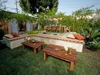 Jamie Durie added a raised deck and dining spot with pops of orange and natural wood.