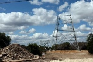 Electric grid will need advancements to keep pace with consumption. (select image for article)  Photo: Towers are assembled for power lines in Central Texas. A proposal to pay companies to build excess generating capability, through what is called a forward capacity market, has caused concern for consumers.